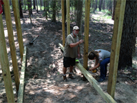 Volunteer Mark Smith and Summer Ranger Tamara Bennett work on building a trail bridge at Sam Rayburn Lake on June 26, 2012.